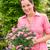 女性 · 花屋 · ホールド · ピンク · 花 · 笑みを浮かべて - ストックフォト © candyboxphoto