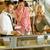 waiter showing women cakes on window display stock photo © candyboxphoto