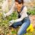 happy woman gardening bush backyard hobby kneeling stock photo © candyboxphoto