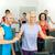 fitness instructor leading gym people exercise stock photo © candyboxphoto