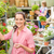 woman buying potted flower in garden shop stock photo © candyboxphoto