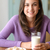 smiling young woman holding glass of milk stock photo © candyboxphoto