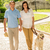 young couple in love walking dog park stock photo © candyboxphoto