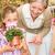 nieta · abuela · flores · sonriendo · amor - foto stock © candyboxphoto