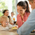 mother and father with child eating cake stock photo © candyboxphoto