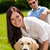 couple sitting with golden retriever in park stock photo © candyboxphoto