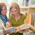 diák · könyvtár · kettő · nő · tart · könyv - stock fotó © candyboxphoto