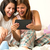 best friends laughing browsing social network stock photo © candyboxphoto
