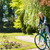 laughing girl riding bicycle in the park stock photo © candyboxphoto