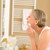 senior woman clean face with cotton pad stock photo © candyboxphoto