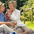 smiling pensioner couple picnicking summer stock photo © candyboxphoto
