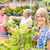 smiling woman at garden centre shopping plants stock photo © candyboxphoto