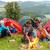 boldog · fiatalok · ül · tábortűz · együtt · csoport - stock fotó © candyboxphoto