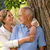 happy pensioner couple cuddling outdoors stock photo © candyboxphoto