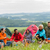 sitting camping friends with tents and landscape stock photo © candyboxphoto
