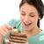 joyful girl eating tasty piece of cake stock photo © candyboxphoto