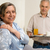 caring senior man bringing breakfast to wife stock photo © candyboxphoto