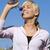 mooie · blond · meisje · drinkwater · blauwe · hemel · sexy - stockfoto © carlodapino
