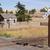 railroad crossing sign tracks abandoned house rural ranch farmla stock photo © cboswell