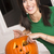 excited happy woman cutting carving halloween pumpkin jack o lan stock photo © cboswell