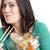 vrouw · eetstokjes · sushi · glimlachend · jonge - stockfoto © cboswell