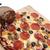 slicing pizza stock photo © cboswell