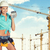 young lady in hard hat holding calculator stock photo © cherezoff
