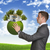 businessman hold earth with small house and trees stock photo © cherezoff
