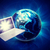 laptop in front of earth on abstract background stock photo © cherezoff