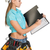 woman in hard hat and tool belt writing on blank clipboard stock photo © cherezoff