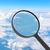 увеличительное · стекло · глядя · облака · небе · свет - Сток-фото © cherezoff