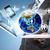 businessman holding earth and electronics stock photo © cherezoff