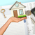 humans hand holding house with key and calculator stock photo © cherezoff