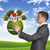 zakenman · houden · aarde · klein · huis · bomen - stockfoto © cherezoff