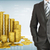 businessman with pyramid of gold coins stock photo © cherezoff
