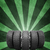 wedge of new car wheels green background is concrete and stripes at bottom stock photo © cherezoff