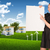 businesswoman holding empty paper house and nature landscape stock photo © cherezoff