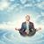 businessman sitting in lotus position on circles stock photo © cherezoff