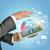 zakenman · houden · aarde · wereldbol · elektronica · communie - stockfoto © cherezoff