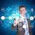 businessman in suit finger presses virtual button stock photo © cherezoff