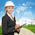 sorridente · empresária · capacete · clipboard · edifício · em · desenvolvimento - foto stock © cherezoff