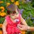 little girl smelling flower stock photo © chesterf