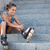 girl sitting on the stairs and puts on skates stock photo © chesterf