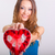 young woman holding heart shaped box stock photo © chesterf
