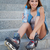 smiling roller girl sitting on the stairs stock photo © chesterf