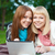two sisters with laptop in the park stock photo © chesterf