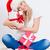 lány · mikulás · kalap · ül · tart · ajándék · doboz - stock fotó © chesterf