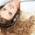 mooie · brunette · vrouwelijke · luisteren · naar · muziek · mp3-speler · tapijt - stockfoto © chesterf