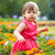 little girl in orange flowers stock photo © chesterf