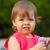 little girl holding flower outdoors stock photo © chesterf
